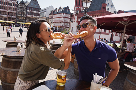 Couple eating pretzels