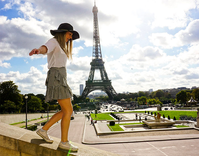 Girl with Eiffel Tower in back